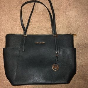Michael Kore saffiano leather purse
